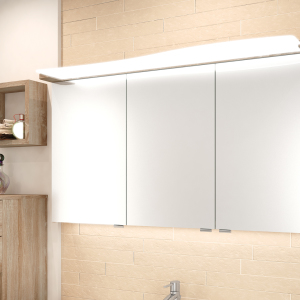 Exklusiv: Spiegelschrank mit geschwungenem LEDAcryldisplay und LED-Lichtleiste im Unterboden zur Ausleuchtung des Waschtisches.
